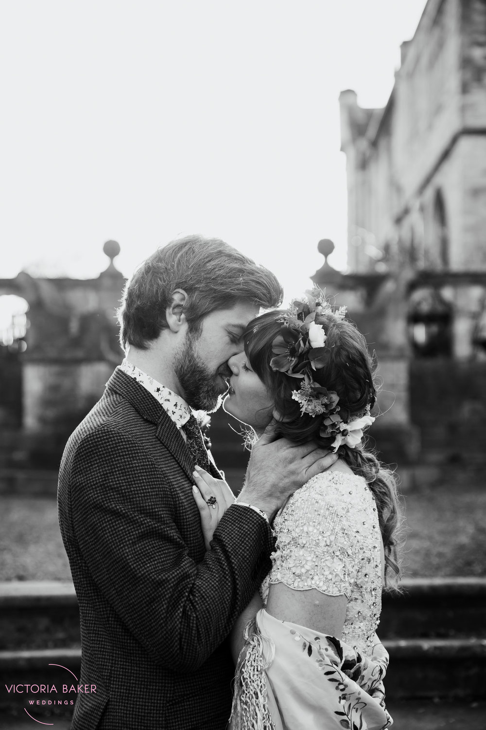 Bride and Groom kissing in black and white at Monk Fryston Hall Leeds Wedding Photographer