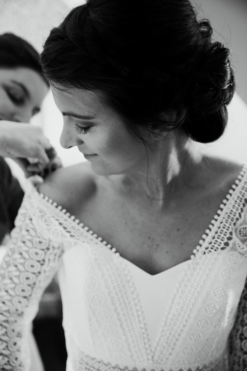 Vanessa getting into her wedding dress at The Chilterns wedding