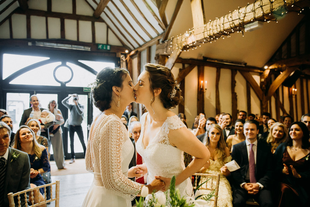 The kiss Vanessa & Hannah wedding ceremony at Old Luxter's Barn at The Chilterns wedding