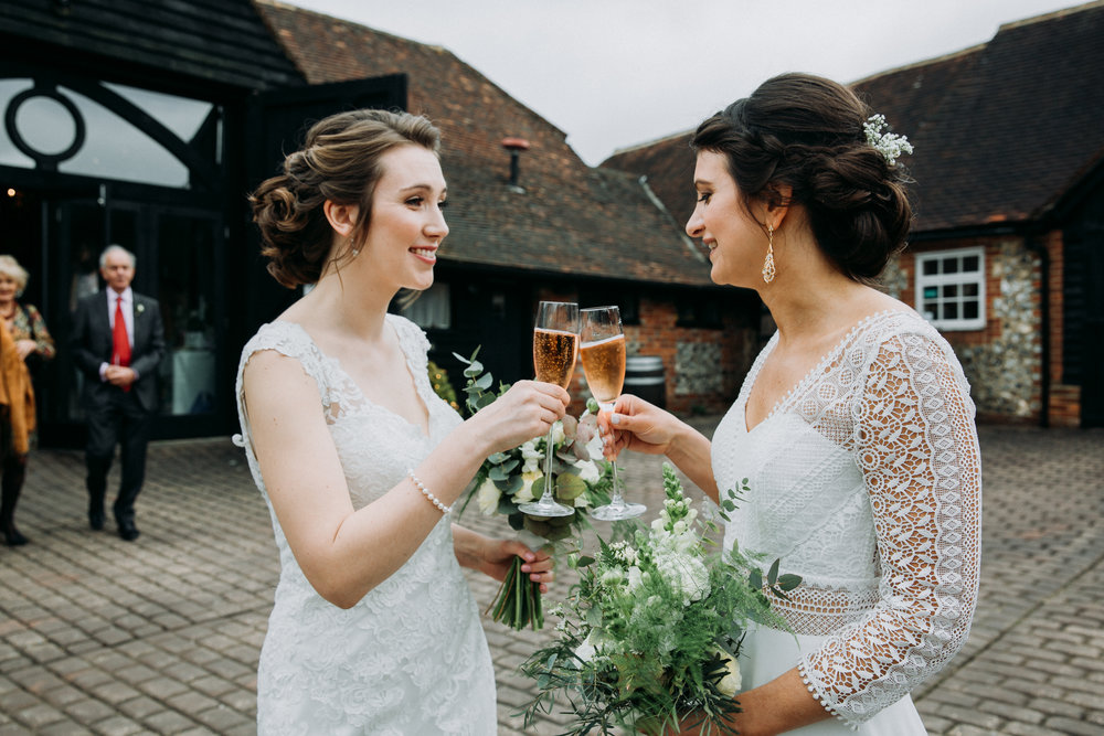 Vanessa & Hannah toasting with champagne at Old Luxter's Barn at Chiltern Winery