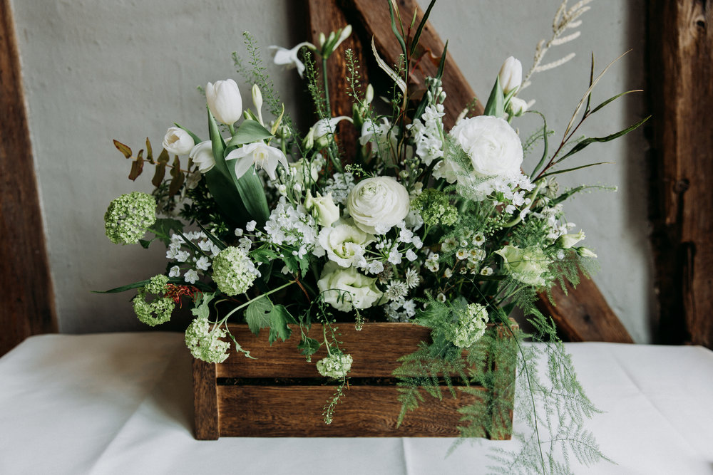 Wooden box of flowers at wedding