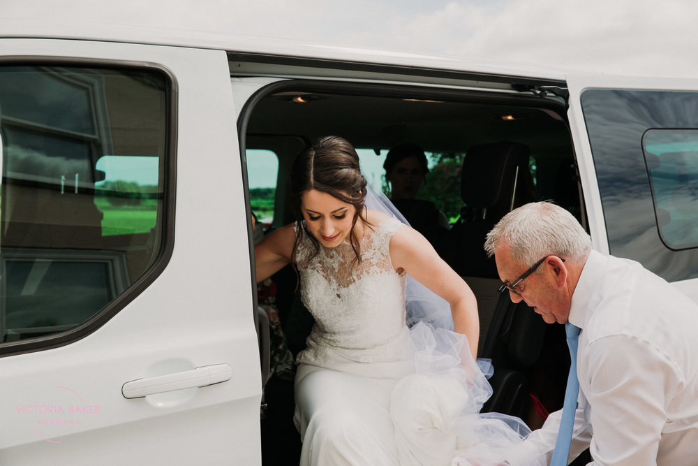 Bride arriving at Barmbyfield Barn | Creative Yorkshire Wedding Photographer