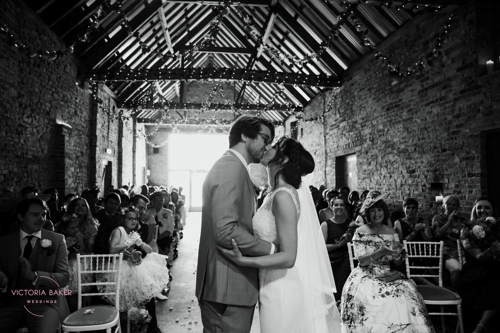 The wedding kiss at Barmbyfield Barn | Creative Yorkshire Wedding Photographer