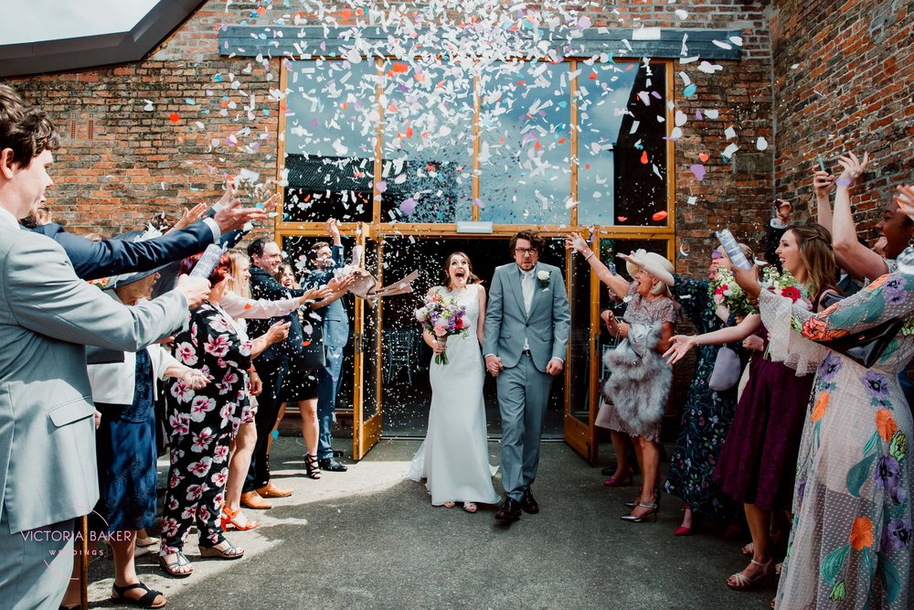 Epic confetti Cannons at Barmbyfield Barn | Creative Yorkshire Wedding Photographer