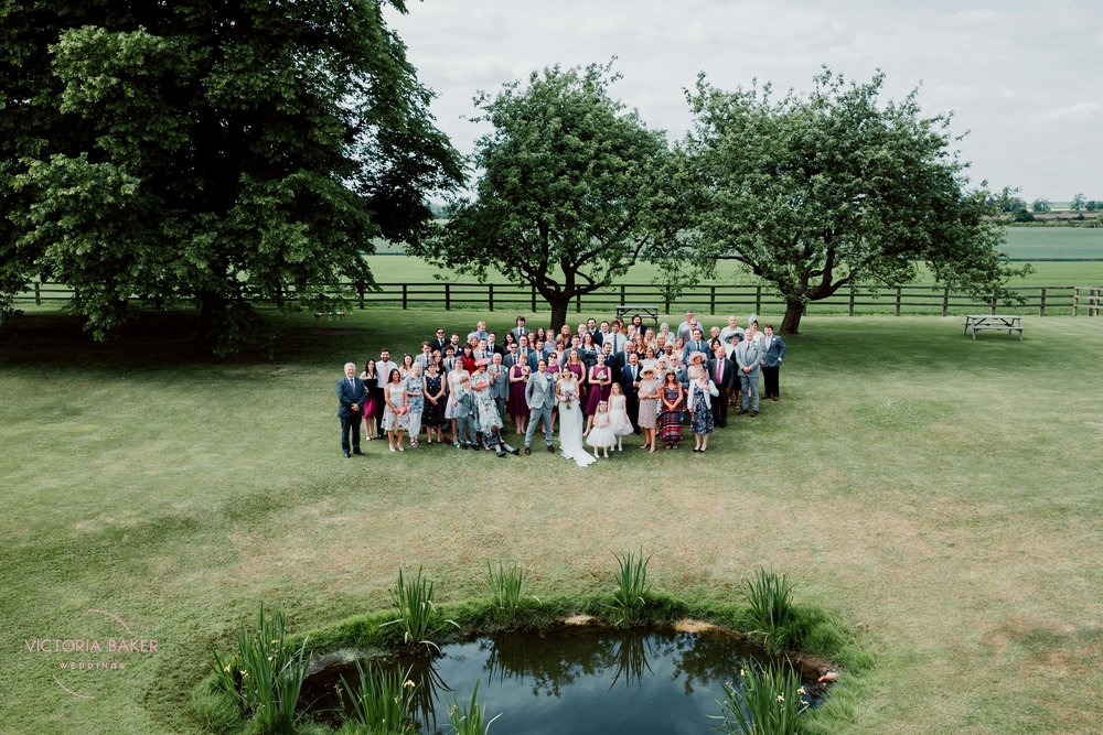Whole wedding party at Barmbyfield Barn | Creative Yorkshire Wedding Photographer