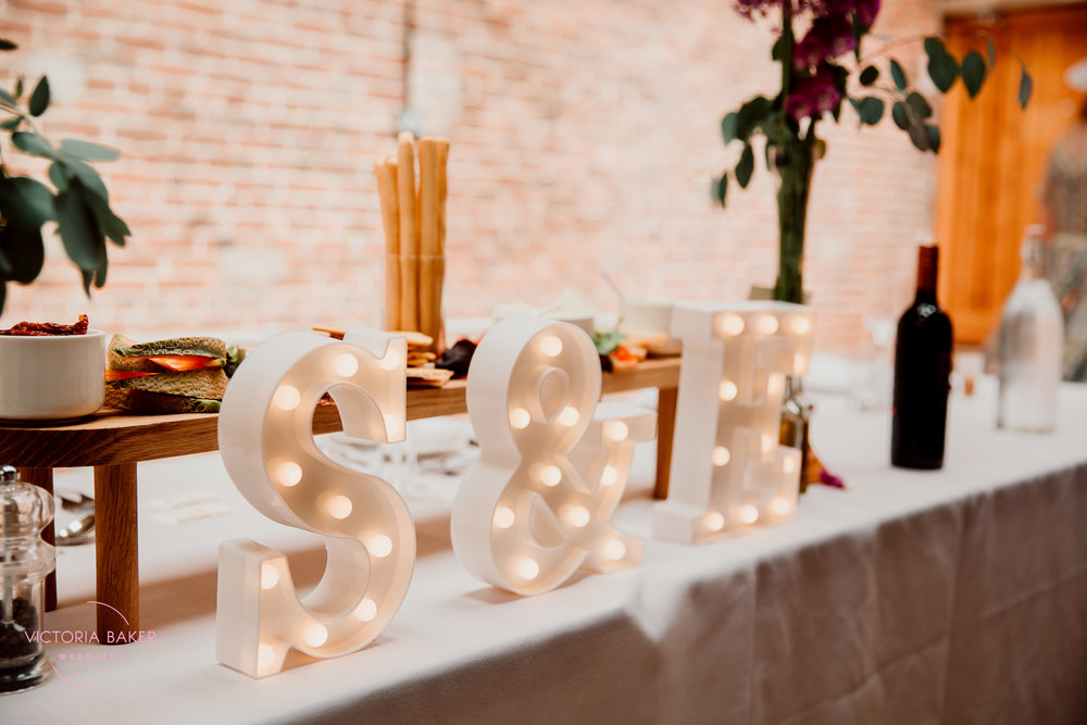 Top Table decoration at Barmbyfield Barn | Creative Yorkshire Wedding Photographer