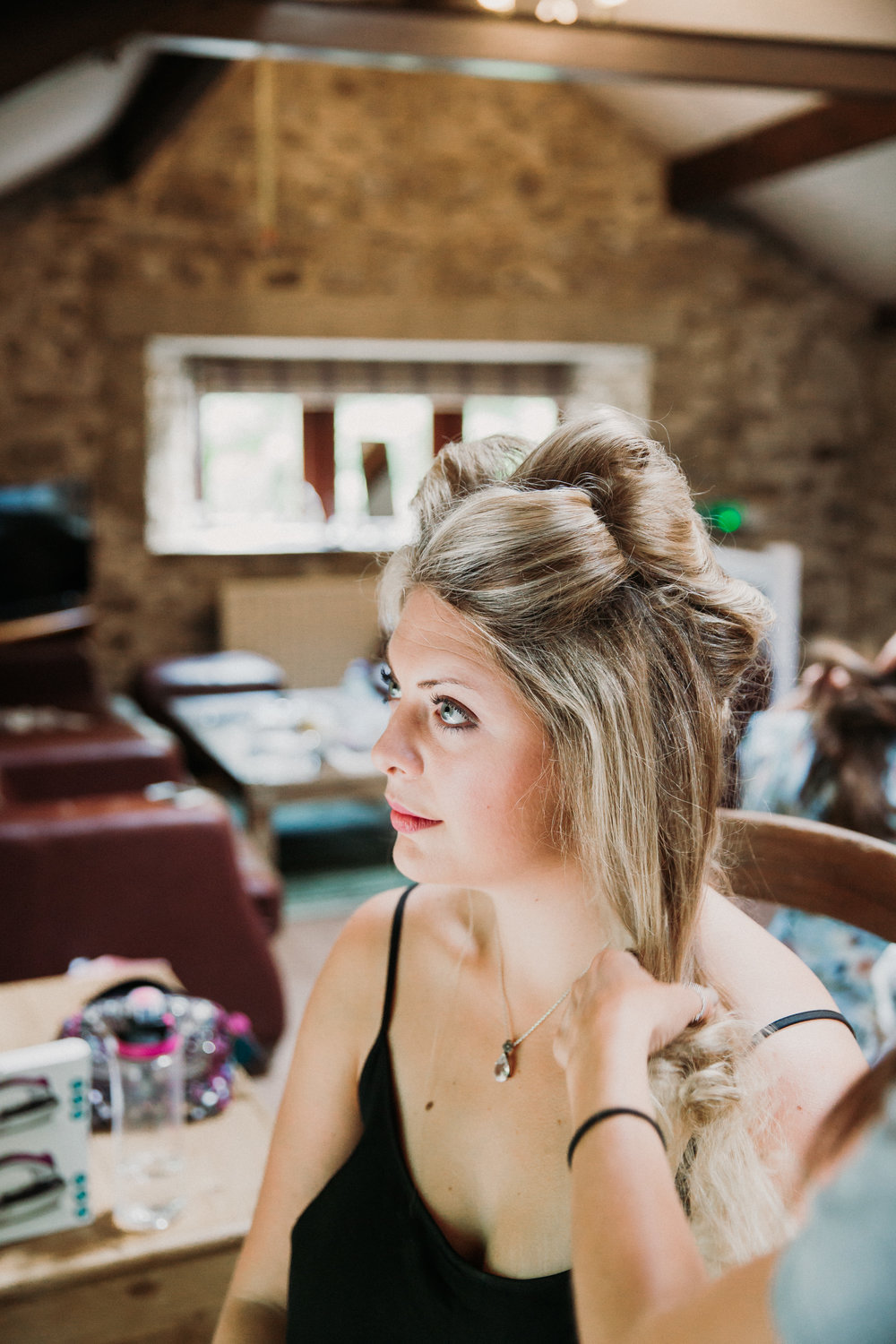 Bridesmaid getting ready at Kilnsey Park Estate