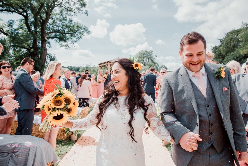 Confetti at Outdoor wedding ceremony at Kilnsey Park Estate Wedding Photography