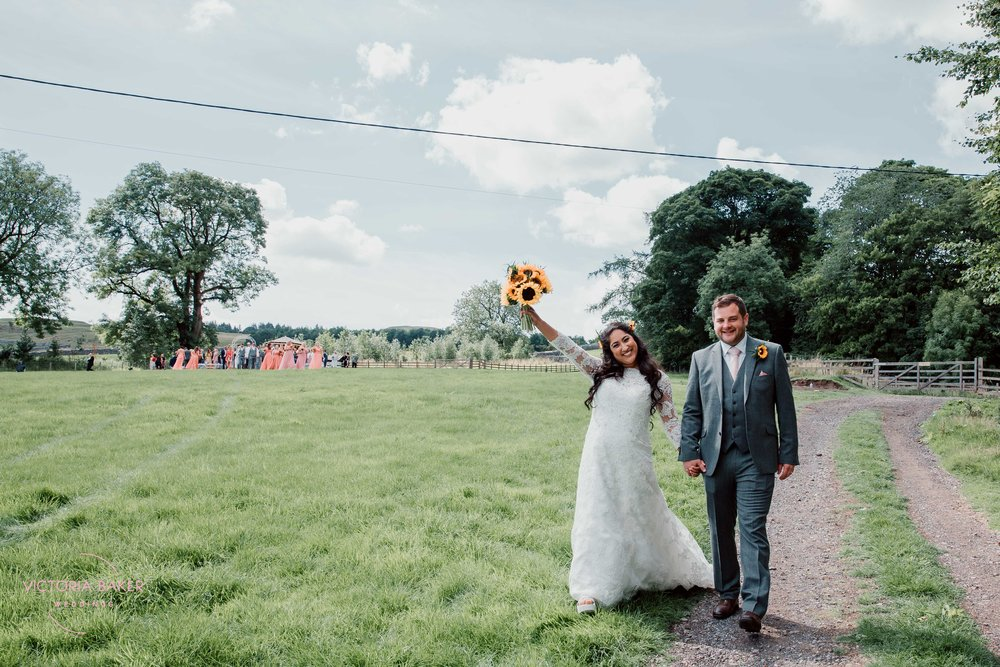 Just married at Outdoor wedding ceremony at Kilnsey Park Estate Wedding Photography