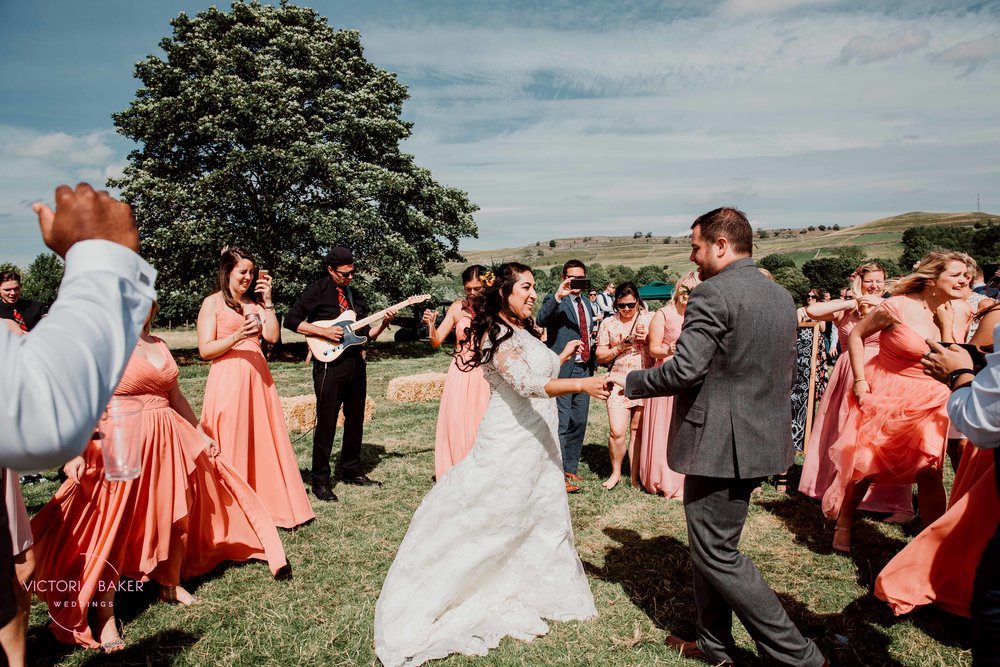 Dancing bride and groom at Kilnsey Park Estate