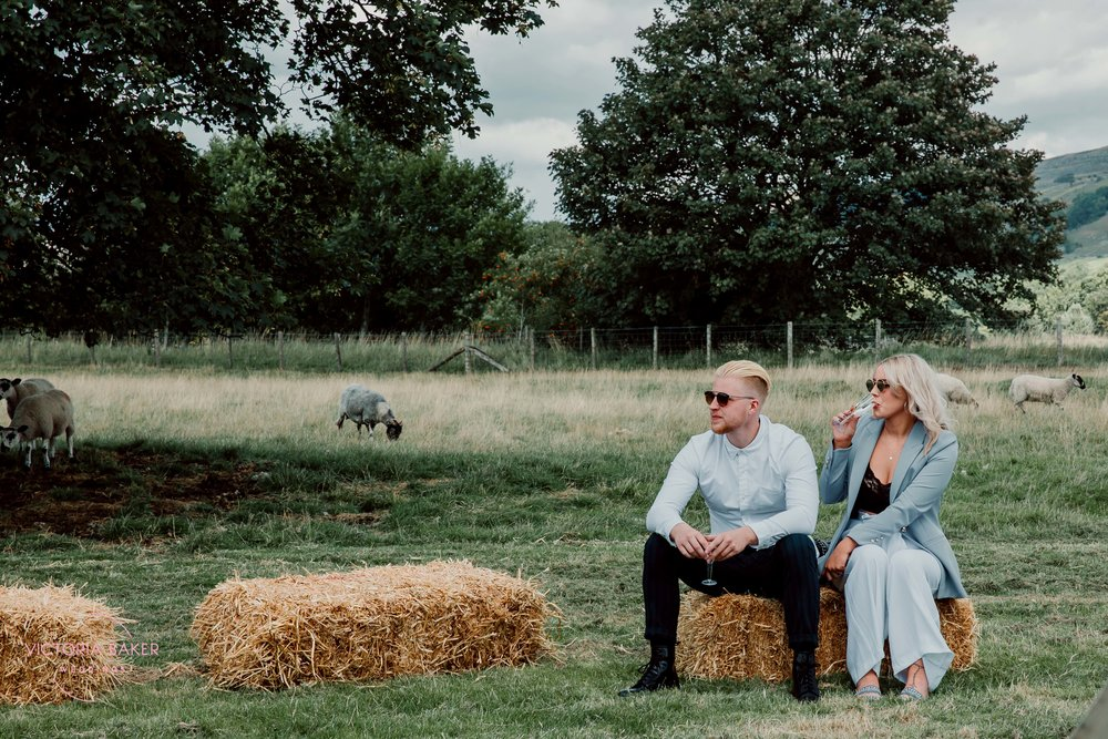 Couple on hay bails at Kilnsey Park Estate