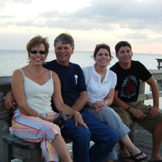 On a pier in Florida a few years ago with my father, brother, and stepmother.