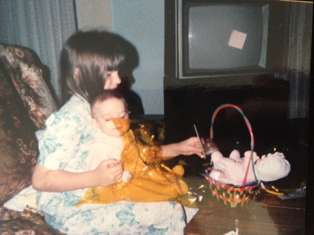 The beginning stages of the youngest being taken care of.  That's Heather helping Michelle open her first Easter Basket.