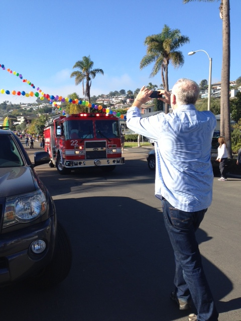 Bob Goff taking a picture of the parade after the fire truck arrived.