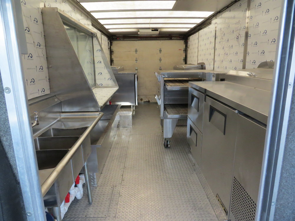 The Brozinni Pizzeria food truck's interior features custom aluminum diamond tread floor plating and much more.