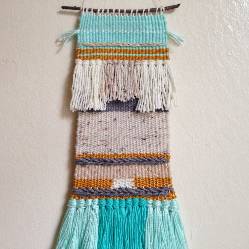 my first try at weaving. see the full image here