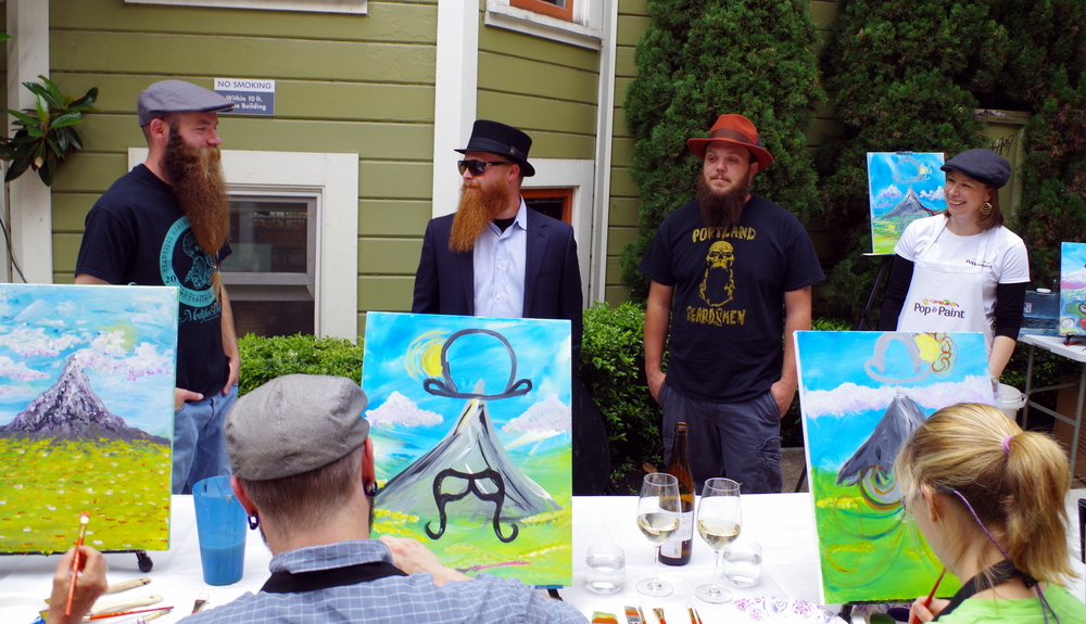 Angie, owner of Pop & Paint, chatting with the Portland Beardsmen!