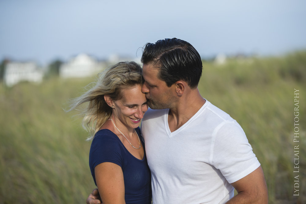 Hardings beach family session on a beautiful day with couple kissing