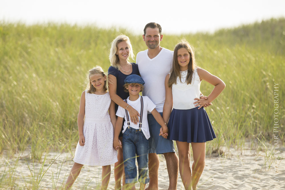 Seagrass and wind as this family poses for their stunning family portrait at the beach
