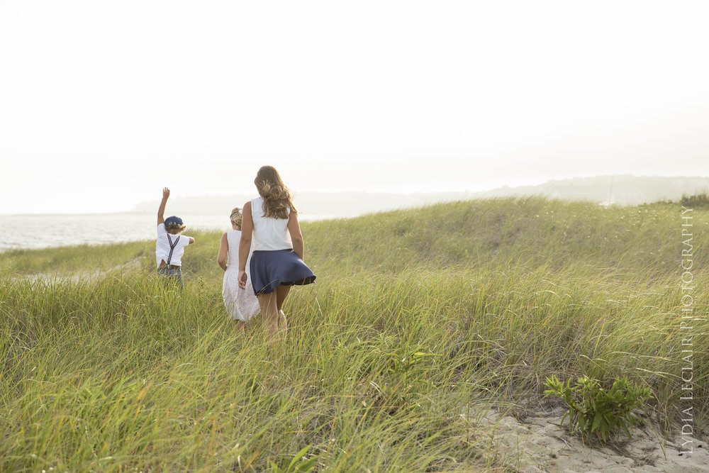 Fun and whimsical documentary session as kids play in the sea grass on their way to the ocean