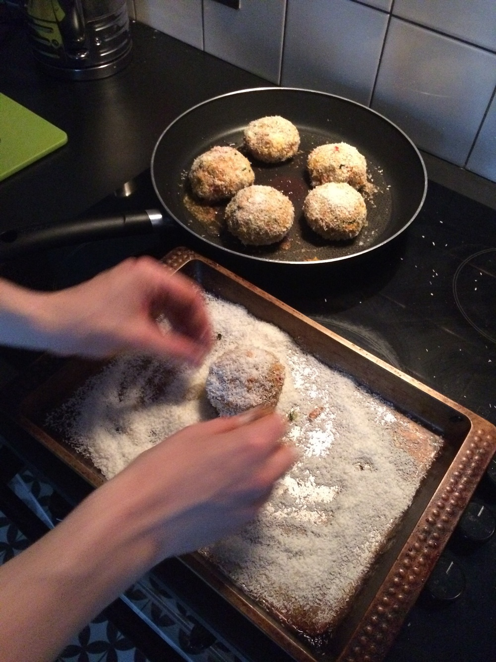 Here I am wrecking the kitchen while rolling the burgers in some coconut for a sweeter outer texture.