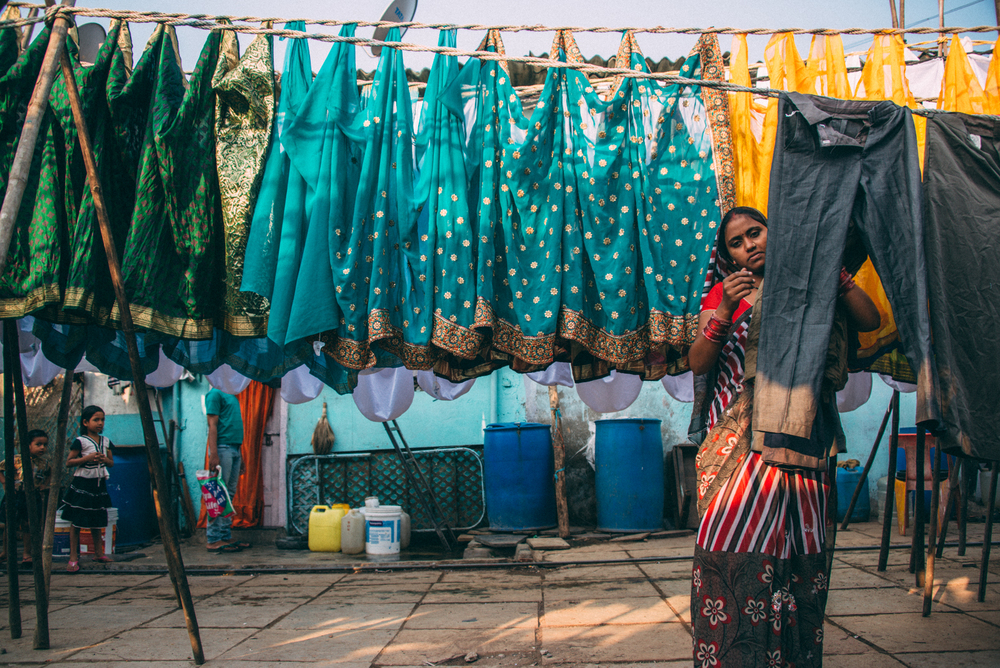I have no idea how they keep track of who owns what clothes but the whole dhobi ghat is completely colour coordinated and efficiently run, returning clothes on the same day if requested all over Mumbai