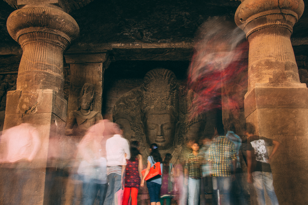 People gather to see an ancient Shiva carving
