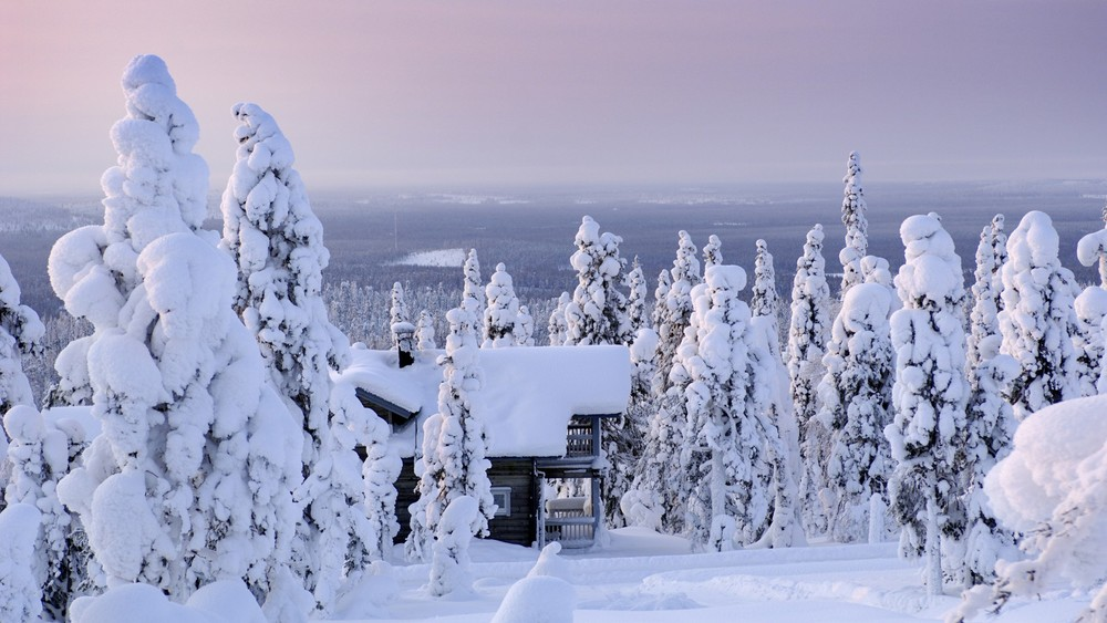 Cabin in the woods in winter via Visit Finland