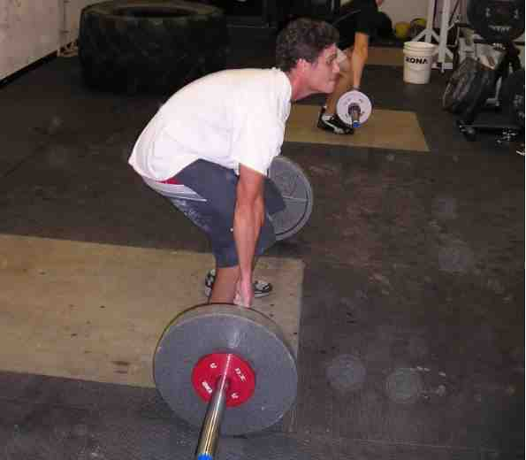 Rounding your back before you've started in the deadlift is a recipe for poor performance and disaster