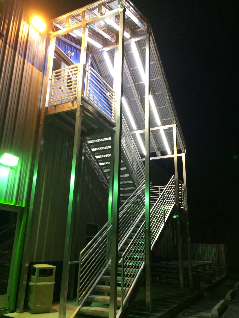 aluminum staircase with open risers and concrete treads.JPG