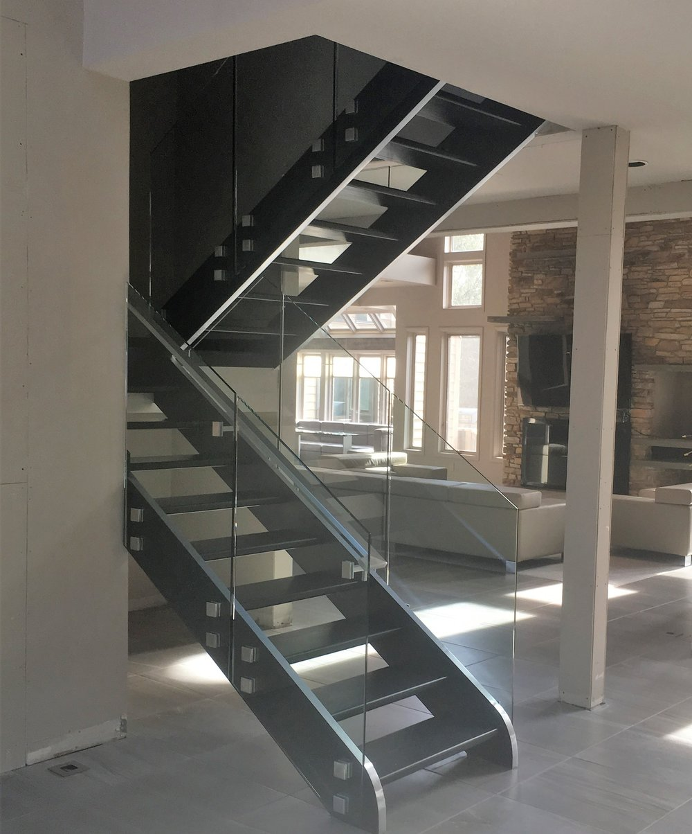 Custom glass railing with standoffs