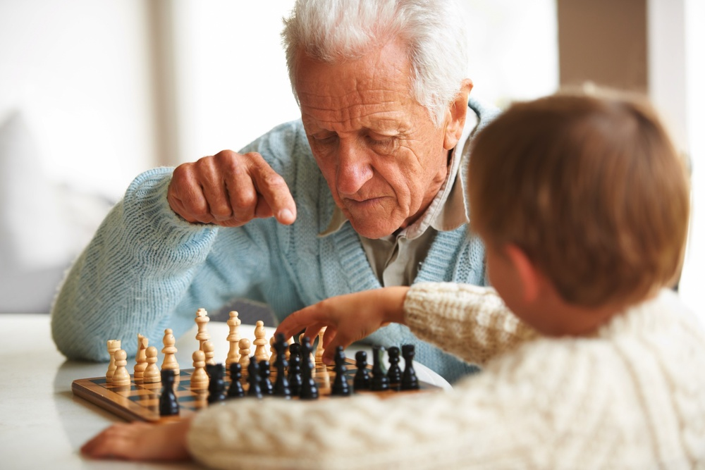 2012 01 01 2 grandpa and kid play chess.jpg