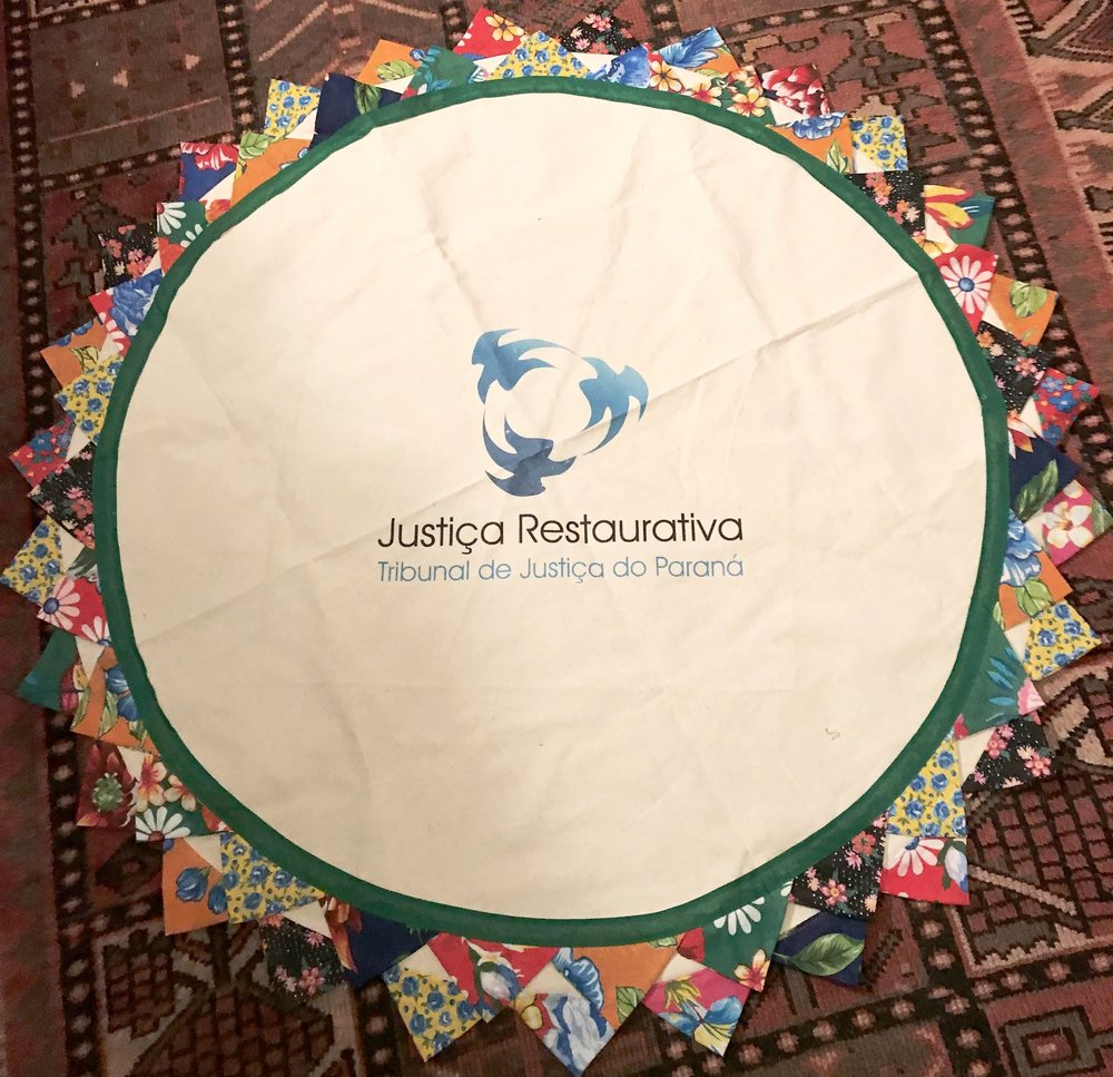 Certainly, a highlight of the morning was a beautiful gift from Jurema Carolina Gomez, representing Tribunal de Justica Restaurative.  The handcrafted circle cloth includes their signature, a design depicting restorative justice in the center.
