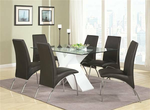 "All beveled glass 72"" x 44"" table top with a very bold base made in deep brown ash hardwood veneers.  4 dark brown comfortable leatherette chairs included, $669 (List $995). Additional chairs are available for $69 each"