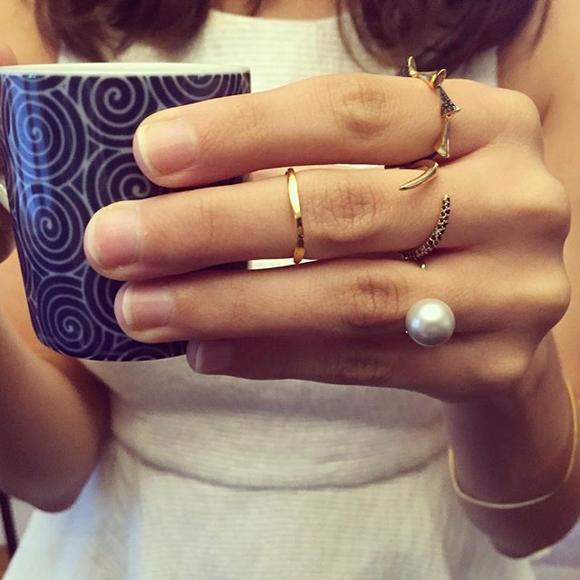 Morning pick me up ☕️ with this biddie || floating pearl ring | ombré black diamond tusk ring | hammer midi ring | 7 thorn black diamond ring | diamond square bangle || #jewelry #blackdiamonds #diamonds #pearls #finejewelry #goldjewelry