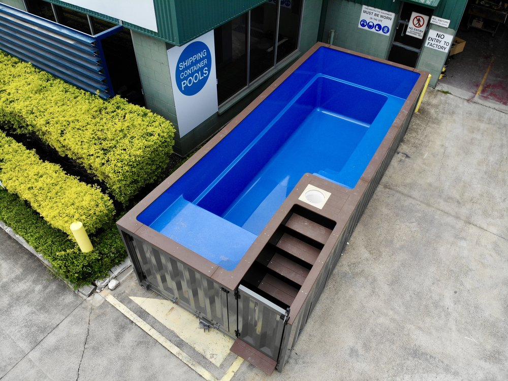 SAFE - THROUGH THE CHILD-SAFETY DOOR, WIDE WOODEN STAIRS LEAD UP TO A LANDING, ALLOWING EASY ACCESS INTO THE SWIMMING POOL.