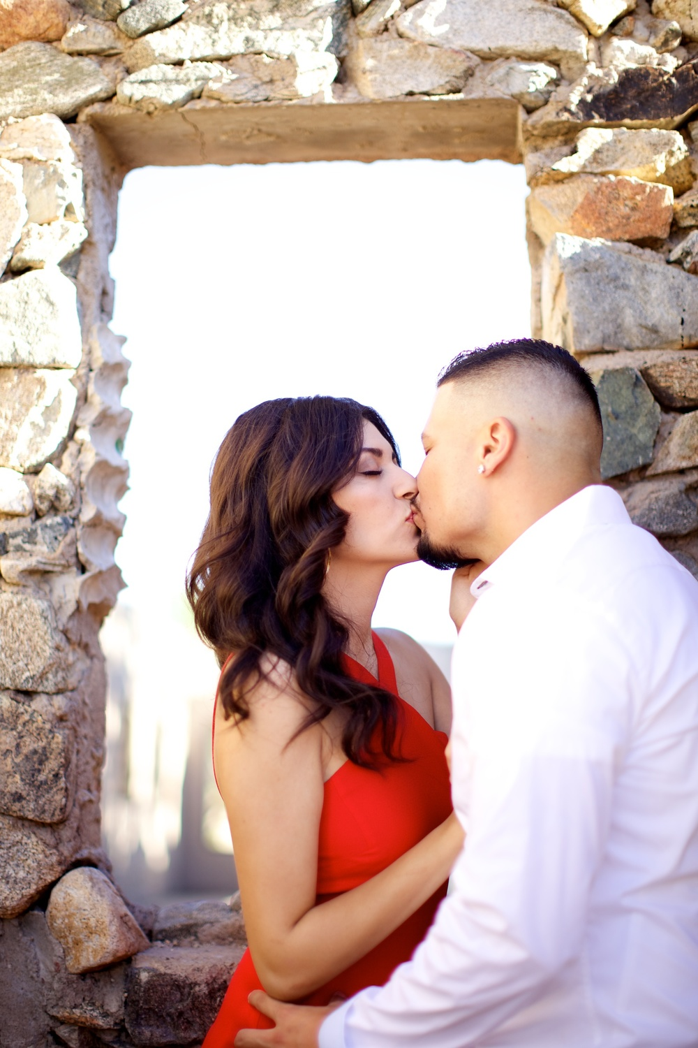 Stone window acts as a natural frame for couples portraits