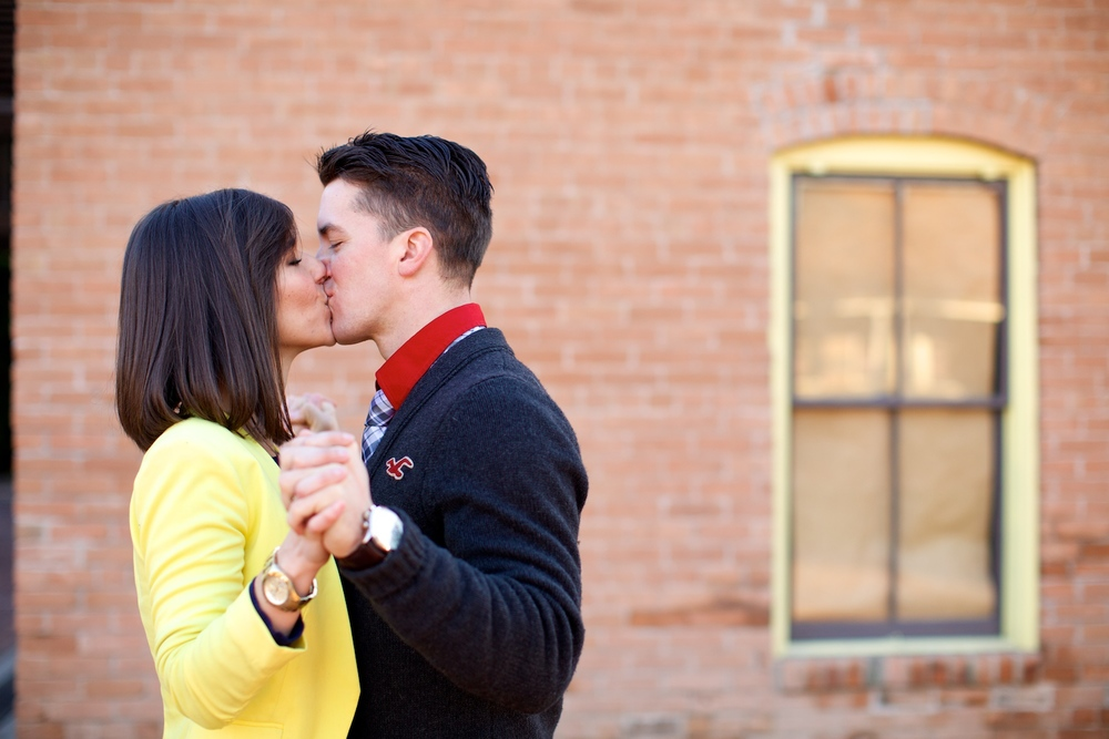 Brick walls and interesting windows create nice backgrounds for engagement pictures