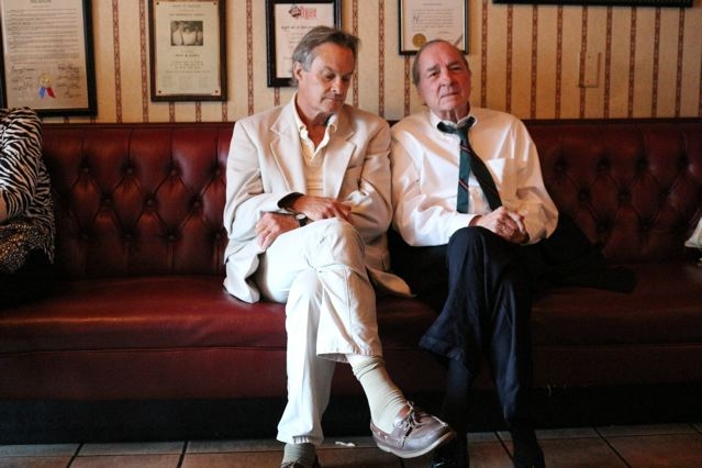 Langdon Clay sitting with William Eggleston. Photo by Maude Clay.