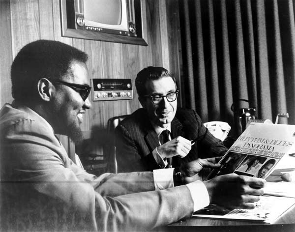 Al Bell and Jim Stewart at their shared desk at the Stax office. Photo from Stax Museum of American Soul Music.