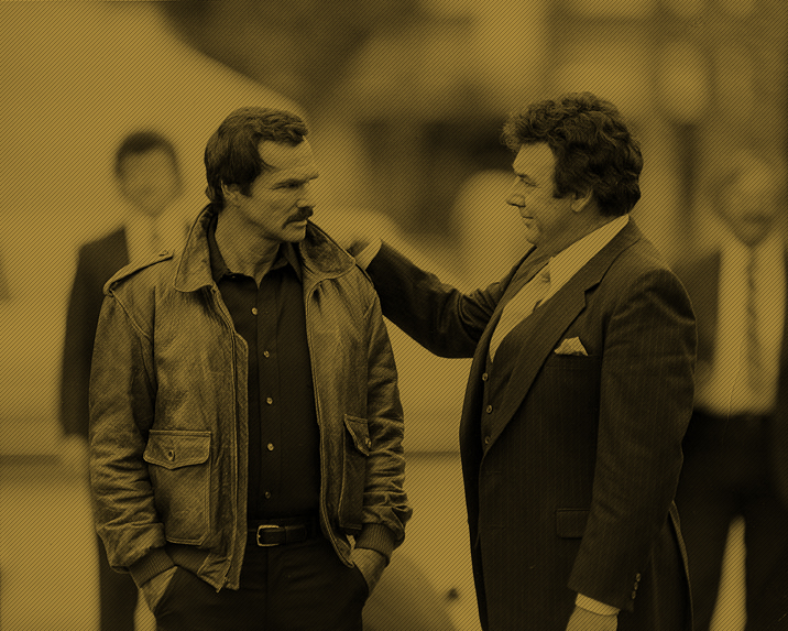 Burt Reynolds with co-star Joseph Mascolo on the set of Sharkey's Machine