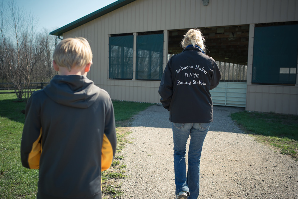 becky Maker and her son jake at R&M racing stables
