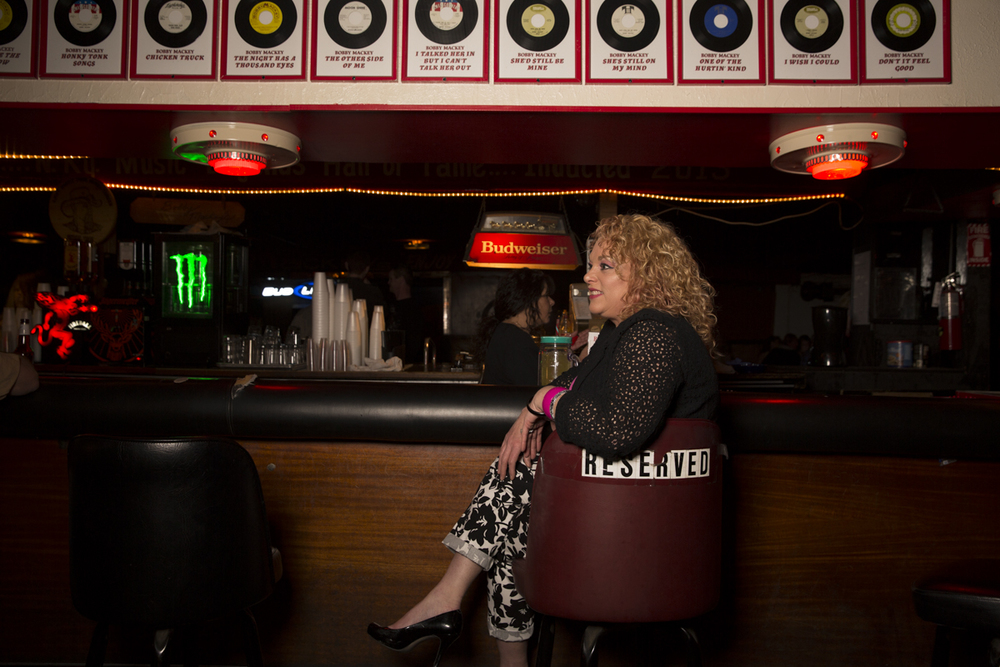 Denise Mackey, Bobby's wife, maintains a seat at the bar. Bobby's first wife, Janet, passed away in 2009.