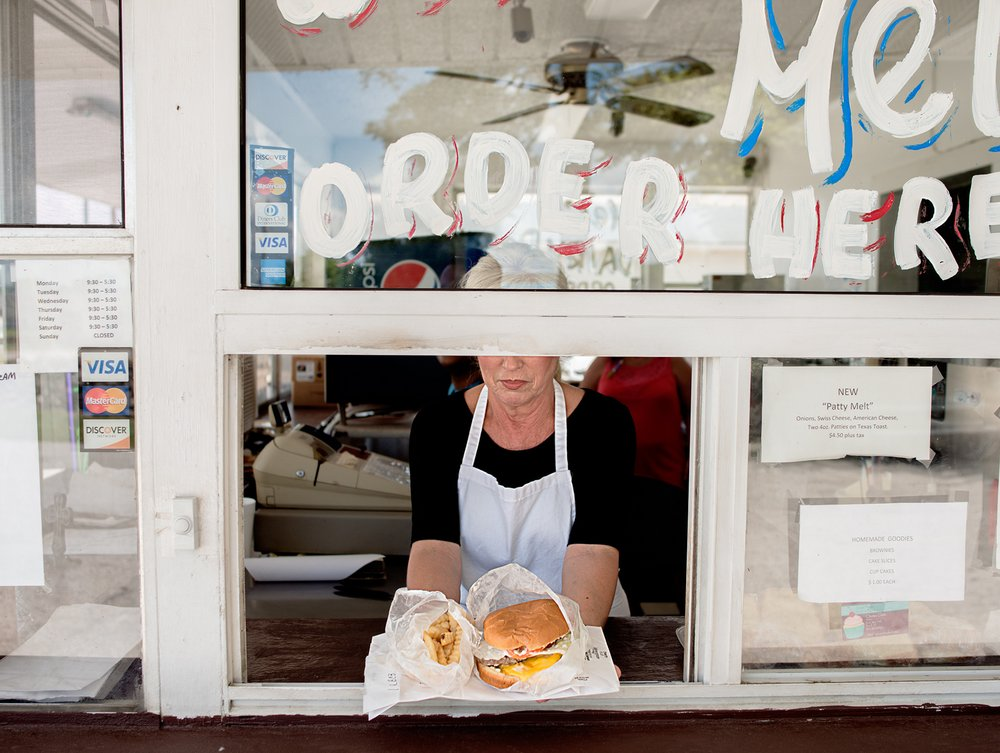 Mel's Dairy Dream,  A burger and fry shack THAT sits on the property where Harper Lee's home once stood.