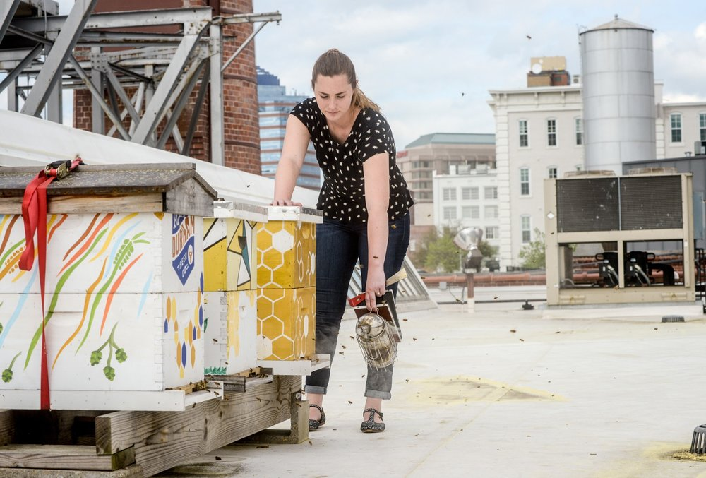 Standing On The Roofs Of Downtown Durham As Bees Thrum Around Her Making Plans To Expand Her Hives Across The South And Around The World Leigh Kathryn