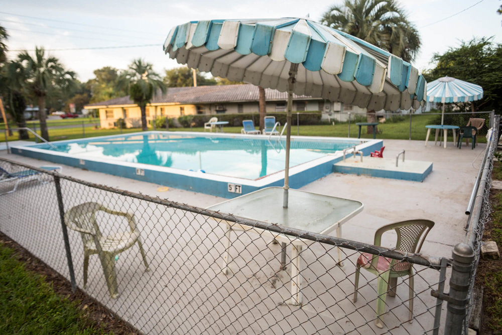 Silver Springs Motel pool and umbrellas.
