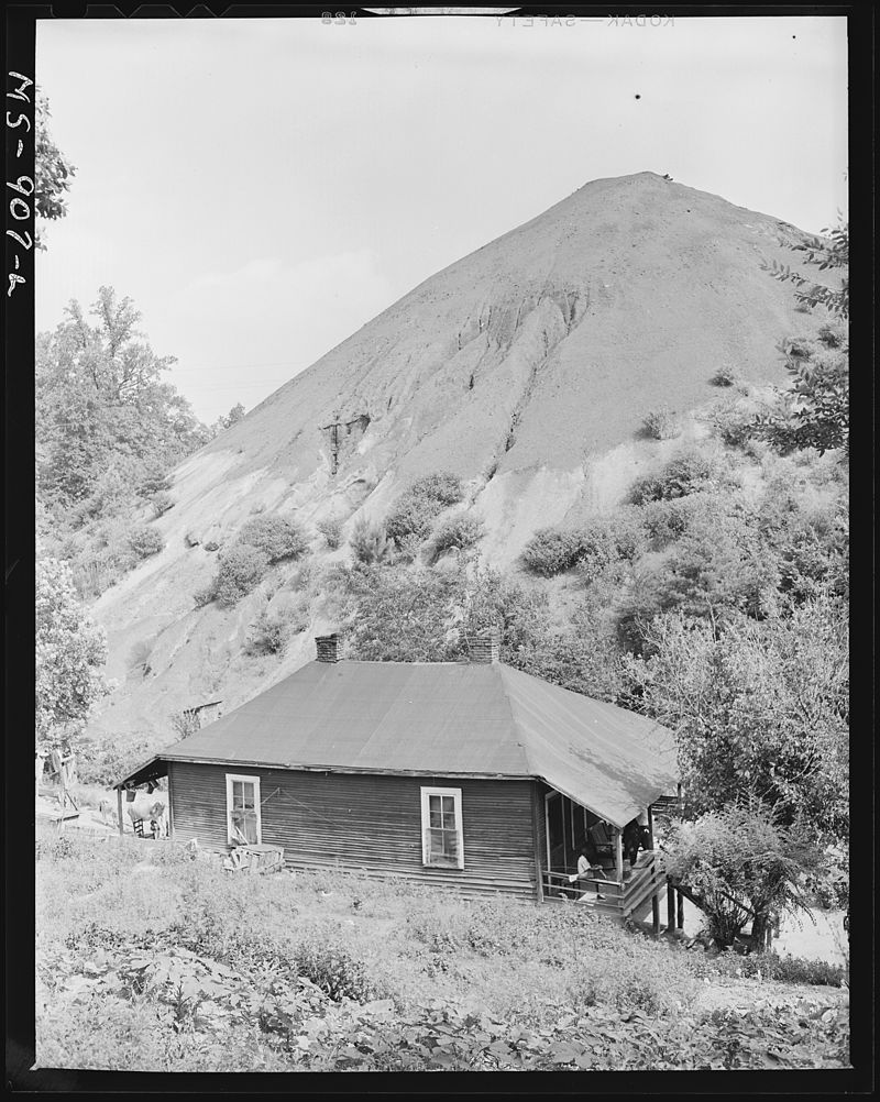 Home_of_Negro_miner_living_in_company_housing_project_with_slag_pole_in_rear._Adams,_Rowe_&_Norman_Inc.,_Porter_Mine..._-_NARA_-_540604.jpg