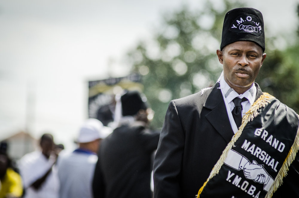 "Jerome Temple (DJ Jubilee) at the Funeral second line for Alfred ""Bucket"" Carter, 2015"