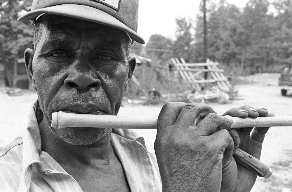 Otha Turner turns a piece of bamboo cane into a fife.jpg