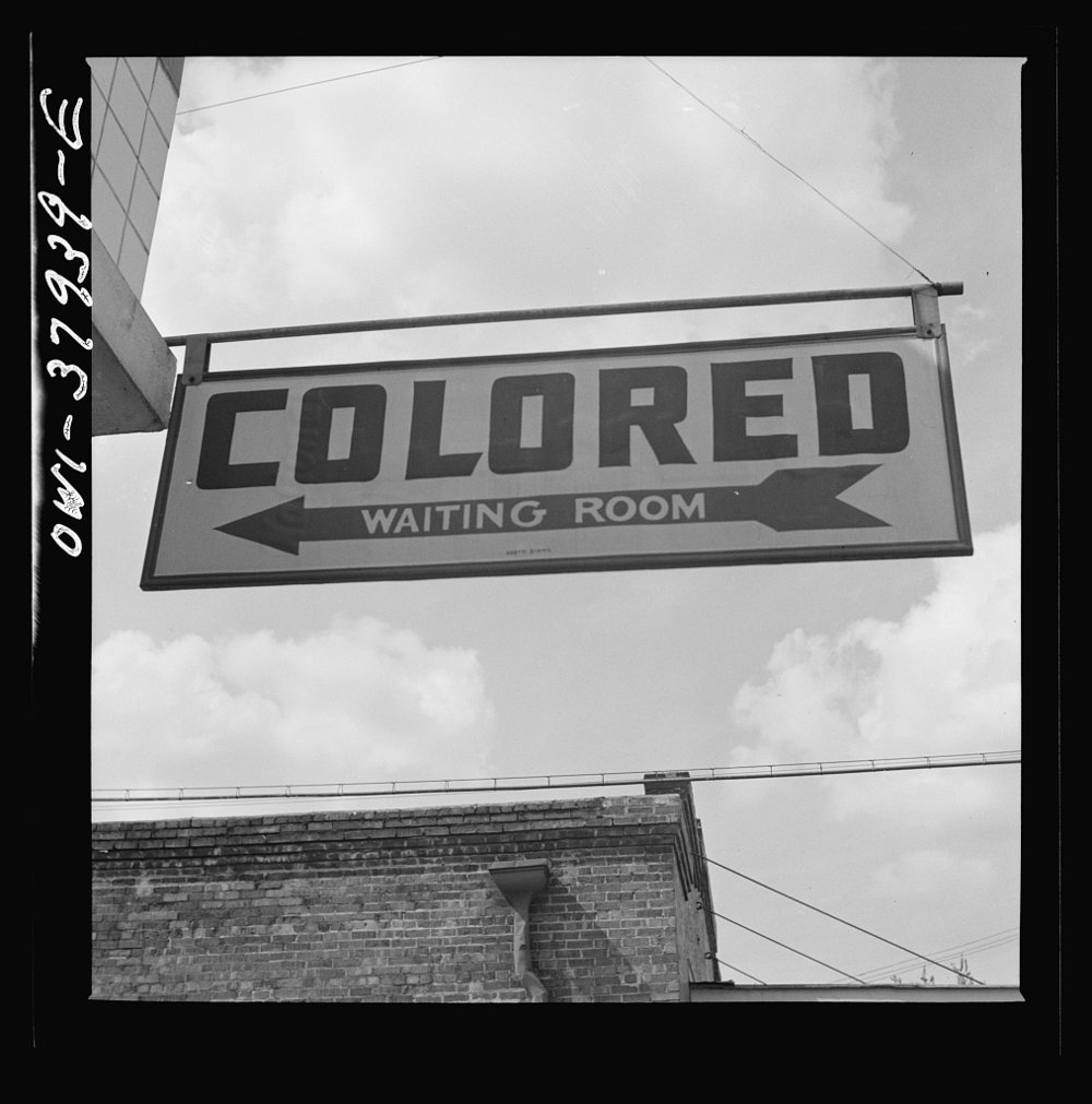 """Colored Waiting Room"" sign from the jim crow era at a Greyhound bus station, Rome, Georgia, 1943"